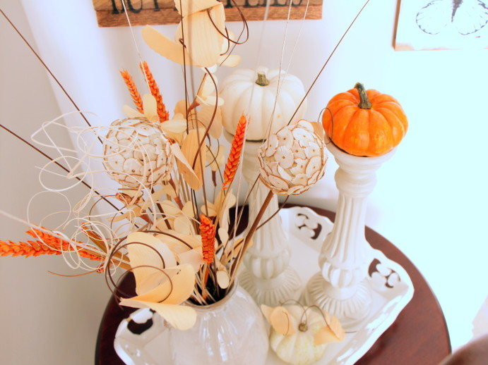 Small pumpkins on candle holders